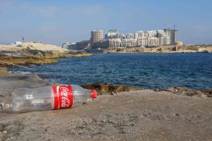 Coke bottle on the shore in Malta