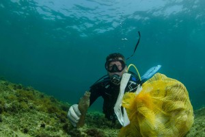 Diver cleaning up in Malta