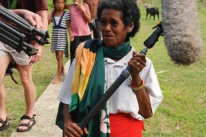 Fijian villagers helping with the film equipment