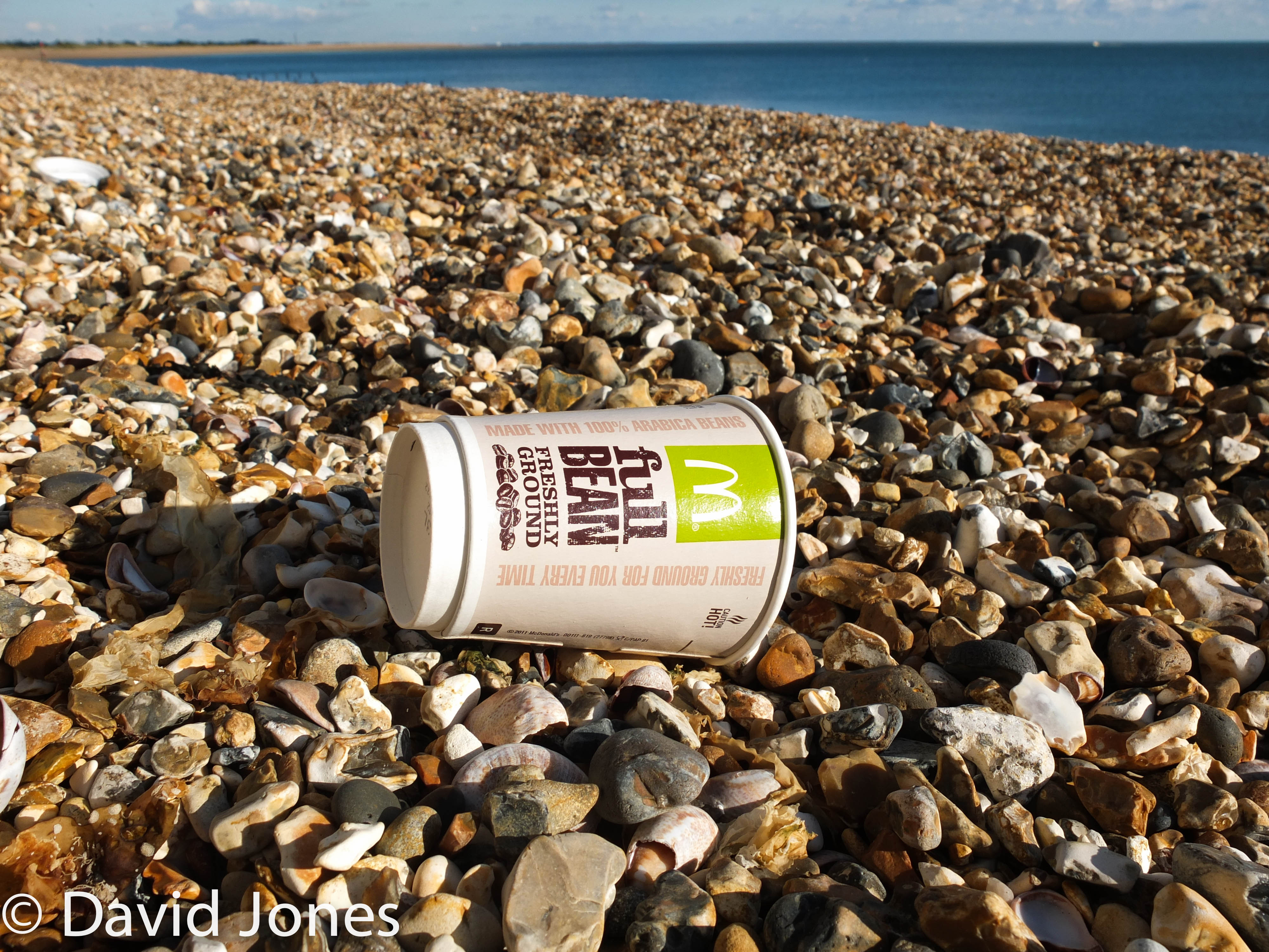 Coffee cup on the beach
