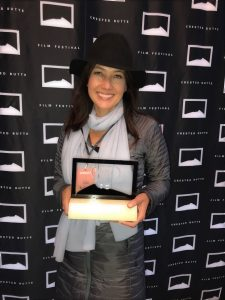 Executive Director Julie Andersen with the ActNow Award from the Crested Butte Film Festival